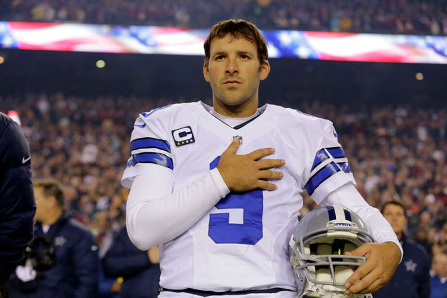 File- This Dec. 30, 2012 file photo shows Dallas Cowboys quarterback Tony Romo (9) standing during the national anthem before an NFL football game against the Washington Redskins in Landover, Md. Romo and the Cowboys have agreed on a six-year contract extension worth $108 million, with about half of that guaranteed. The agreement was reported on the team's website Friday March 29, 2013. (AP Photo/Alex Brandon, File) / AP