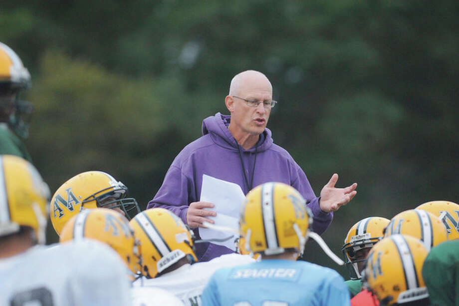 Hour photo/Matthew Vinci Norwalk Youth Football Coach John Woodring, a former player for the New York Jets who presently coaches the eighth grade Packers, talks to his team at Brien McMahon High School last week during a practice. / (C)2011, The Hour Newspapers, all rights reserved