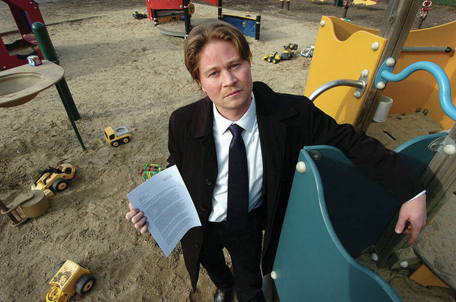 Photo/ Alex von Kleydorff. Nathan Cloutier at his 3-year-old daughter's favorite playground in Cherry Lawn Park. The Stamford resident has initiated a petition seeking to get automatic joint custody for Conn. parents. / 2011 The Hour Newspapers