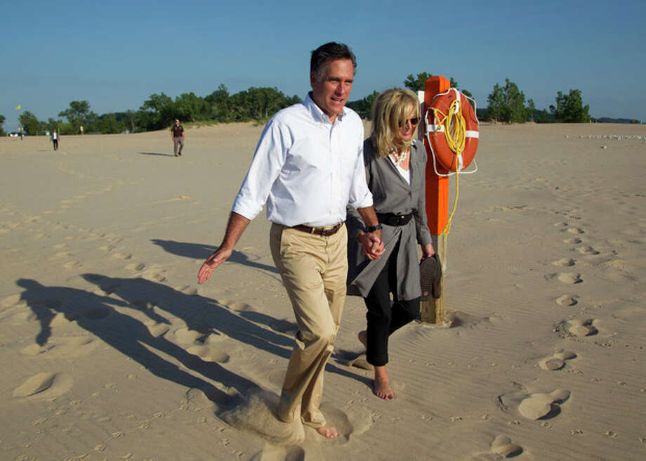 Republican presidential candidate, former Massachusetts Gov. Mitt Romney, left, takes a walk with his wife Ann, on the beach after a campaign stop at Holland State Park on Tuesday, June 19, 2012 in Holland, Mich. (AP Photo/Evan Vucci) / Copyright 2012 The Associated Press. All rights reserved. This material may not be published, broadcast, rewritten or redistributed.