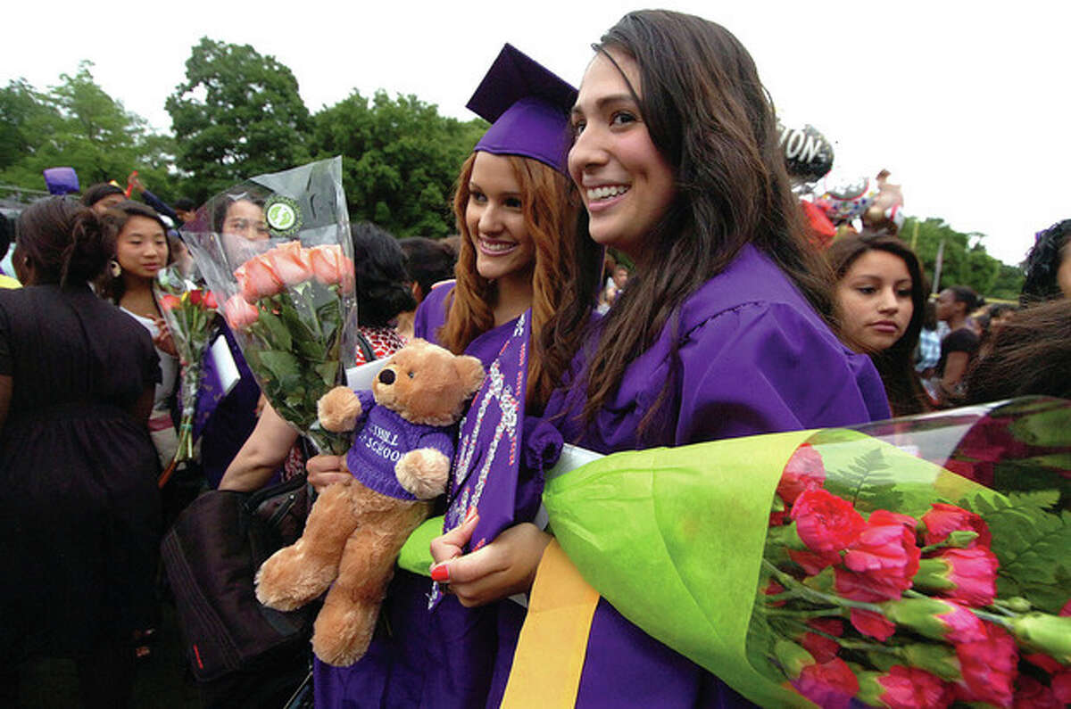 Photo/Alex von Kleydorff. Janibell Monegro and Roversy Ventura pose for a photo at the Westhill High School graduation on Thursday.