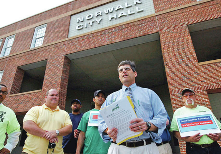 Hour photo / Erik TrautmannAFSME Council 4 spokesman Larry Dorman and others who object to garbage privatization address the press and while protesting outside City Hall on Tuesday afternoon. / (C)2012, The Hour Newspapers, all rights reserved