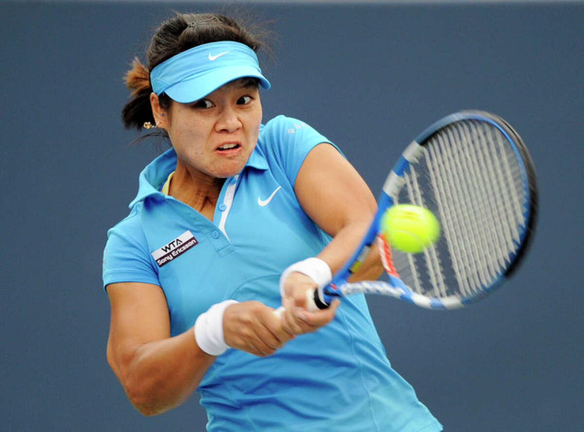 Li Na, of China, hits a backhand during the first set of her quarterfinal match against Anastasia Pavlyuchenkova, of Russia, at the New Haven Open tennis tournament in New Haven, Conn., on Thursday, Aug. 25, 2011. (AP Photo/Fred Beckham)