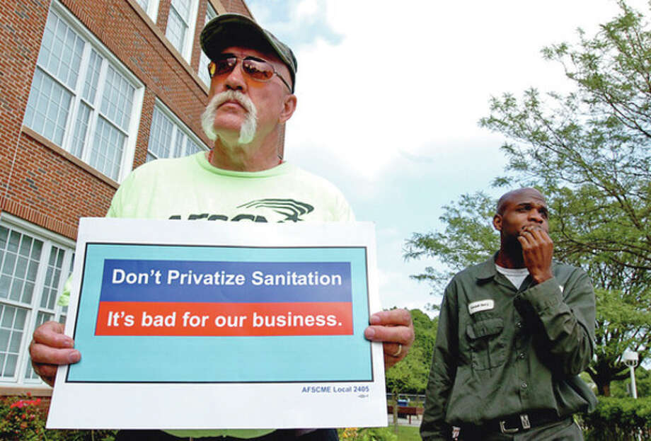 Hour photo / Erik TrautmannAFSME Local 2405 member Bela Garrison and others who object to the privatization of the city of Norwalk's garbage pickup gather to protest outside City Hall. / (C)2012, The Hour Newspapers, all rights reserved