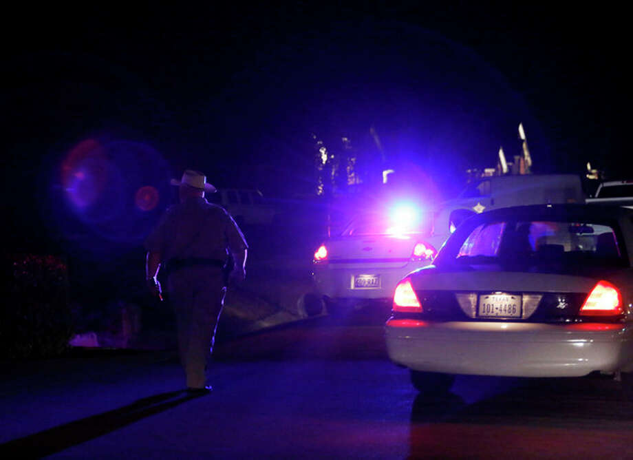 In this Saturday, March 30, 2013 photo, police block off Blarney Stone Road in Forney, Texas, where Kaufman County District Attorney Mike McLelland and wife Cynthia McLelland were found dead in their home near Forney, Texas. (AP Photo/The Dallas Morning News, Ian C. Bates) MANDATORY CREDIT; MAGS OUT; TV OUT; INTERNET USE BY AP MEMBERS ONLY; NO SALES / The Dallas Morning News