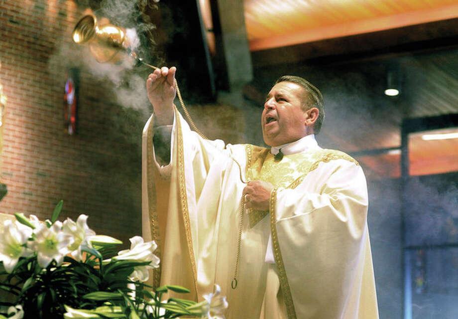 Hour photos / Matthew VinciThe Rev. Monsignor Walter Orlowksi, pastor at St. Matthew Parish, celebrates Mass on Easter Sunday.