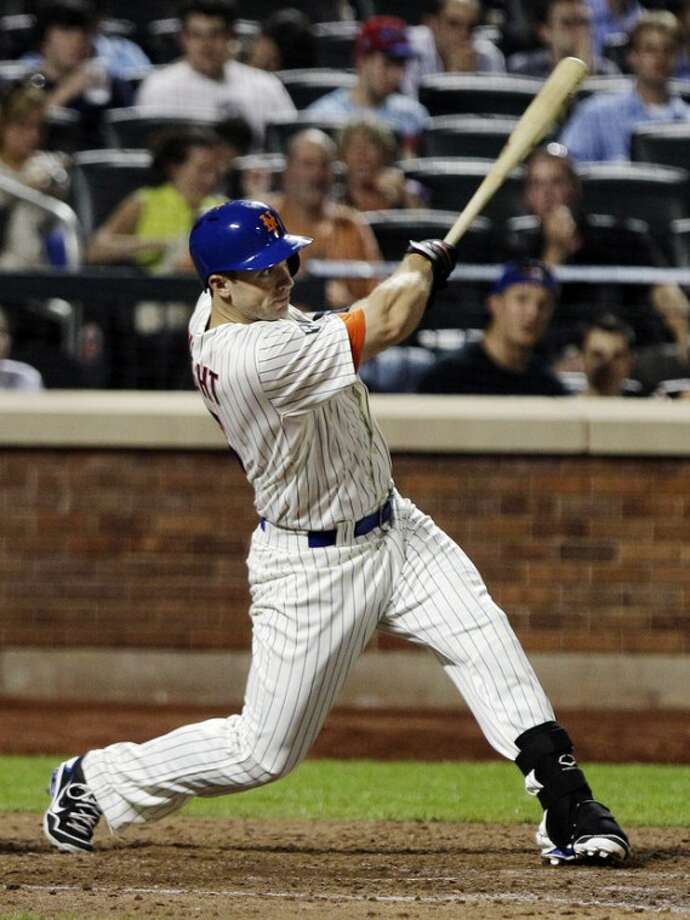 New York Mets' David Wright follows through on a double to drive in a run during the sixth inning of an interleague baseball game against the Baltimore Orioles, Wednesday, June 20, 2012, in New York. (AP Photo/Frank Franklin II)