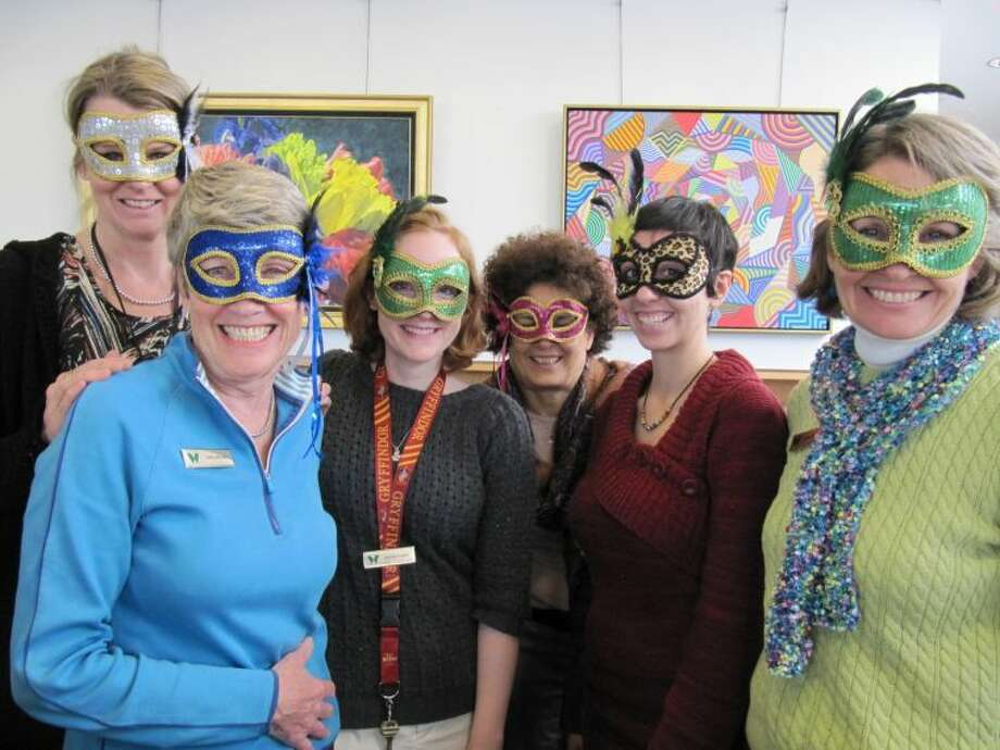The staff at the Wilton Library show off their masks in preparation for the library's upcoming 'Beyond Words' benefit on April 5th.