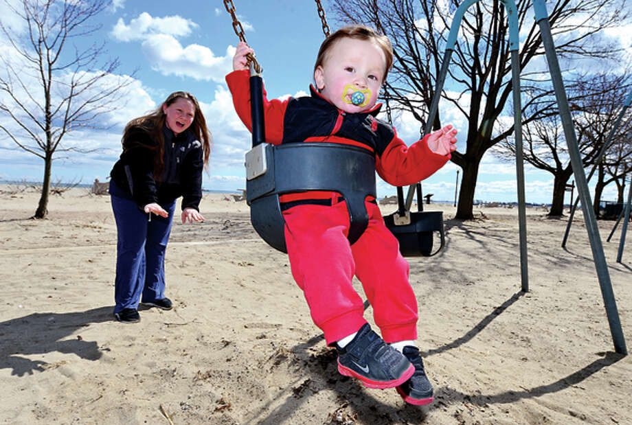 Megan Catocho and her 16 month old son, Jonathan, enjoy mild temperatures at Calf Pasture Beach as Spring weather starts to make an appearance Tueday. Hour photo / Erik Trautmann / (C)2013, The Hour Newspapers, all rights reserved