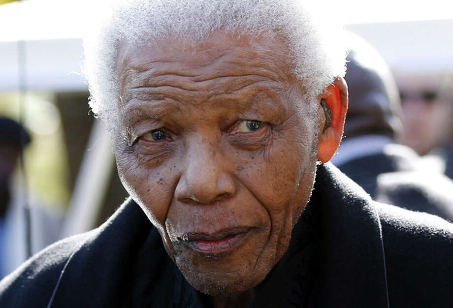 FILE - In this June 17, 2010 file photo, former South African President Nelson Mandela leaves the chapel after attending the funeral of his great-granddaughter Zenani Mandela in Johannesburg, South Africa. The South African presidency says Nelson Mandela was re-admitted to hospital with a recurrence of a lung infection Thursday March 28, 2013. (AP Photo/Siphiwe Sibeko, Pool, File) / The Associated Press2012