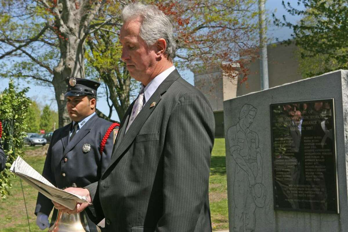 Kevin Byrnes reads the names of the dead during the 23rd annual memorial ceremony of L'Ambiance Plaza on Friday, April 23, 2010. L'Ambiance Plaza collapsed in 1987 during construction killing 28 construction workers.