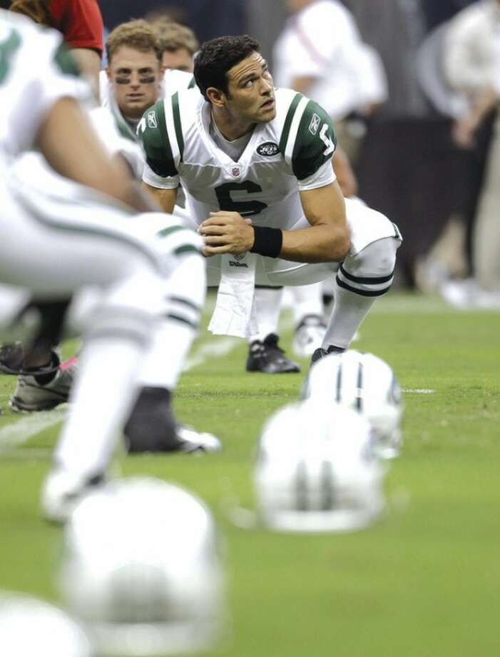 @White=[C] AP photo New York Jets quarterback Mark Sanchez loosens up on the sidelines. Jets coach Rex Ryan includes Sanchez among the NFL's elite quarterbacks.