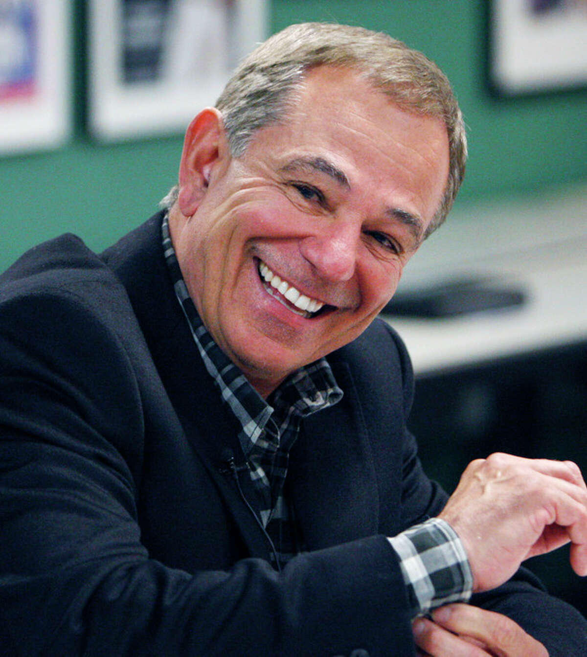 FILE-This Nov. 21, 2011 file photo shows ESPN analyst Bobby Valentine smiling as he answers questions from reporters following his interview for the vacant Boston Red Sox manager position, at Fenway Park in Boston. A person familiar with the decision says the Boston Red Sox have chosen Bobby Valentine to be their next manager and were working to complete a contract. The person spoke to The Associated Press on condition of anonymity Tuesday Nov. 29, 2011 because no announcement had been made. (AP Photo/Bizuayehu Tesfaye, File)