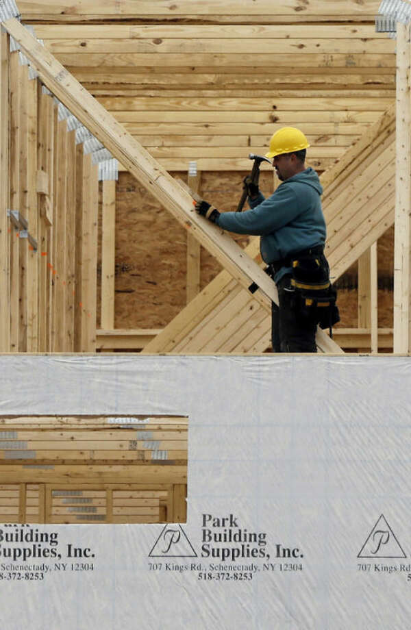 In this Feb. 25, 2013 photo, a new townhouse is under construction at the Crossings adult community in Colonie, N.Y. Sales of new homes fell in February after climbing to the highest level in more than four years in January. (AP Photo/Mike Groll)