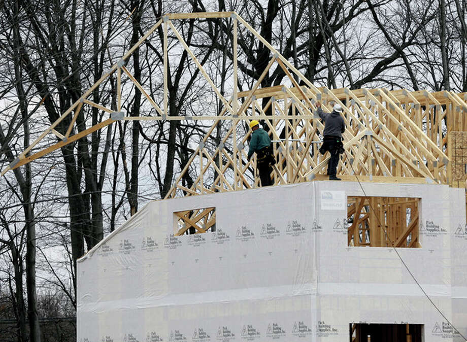 In this Feb. 25, 2013 photo, a new townhouse is under construction at the Crossings adult community in Colonie, N.Y. Sales of new homes fell in February after climbing to the highest level in more than four years in January. (AP Photo/Mike Groll) / AP