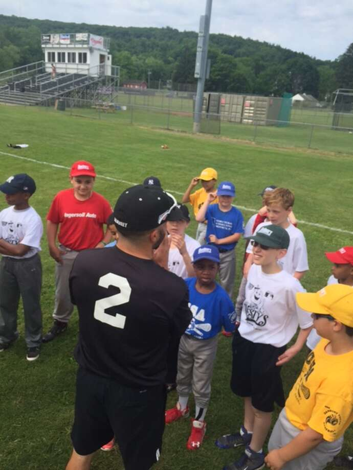 Danbury Westerners assistant coach Dave Simone (2) works with a group of youngsters at the Danbury Westerners' Kids Clinic at Rogers Park in Danbury June 11, 2016. Photo: Contributed Photo / Contributed Photo