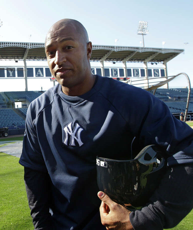 New York Yankees outfielder Vernon Wells heads to the dugout after signing with the Yankees and taking batting practice before the baseball team's spring training game against the Houston Astros at Steinbrenner Field in Tampa, Fla., Tuesday, March 26, 2013. (AP Photo/Kathy Willens) / AP