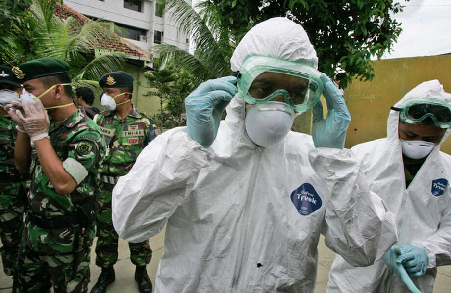 FILE - In this Tuesday, Dec. 16, 2008 file photo, soldiers wear protective gear during a bird flu prevention drill in Jakarta, Indonesia. The second of two bird flu studies once considered too risky to publish was released Thursday, June 21, 2012 ending a saga that pitted concerns about terrorism against fears of a deadly global epidemic. Both papers describe how researchers created virus strains that could potentially be transmitted through the air from person to person. Scientists said the results could help them spot dangerous virus strains in nature. (AP Photo/Irwin Fedriansyah) / AP2008