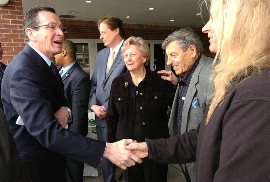 Hour Photo/Alex von Kleydorff Governor Dan Malloy meets the Sarno family, the property owners, while talking about the new C-PACE Energy program for Commercial and Industrial buildings at 542 Westport Ave where Bow Tie Cinemas are, which will be the first to upgrade.