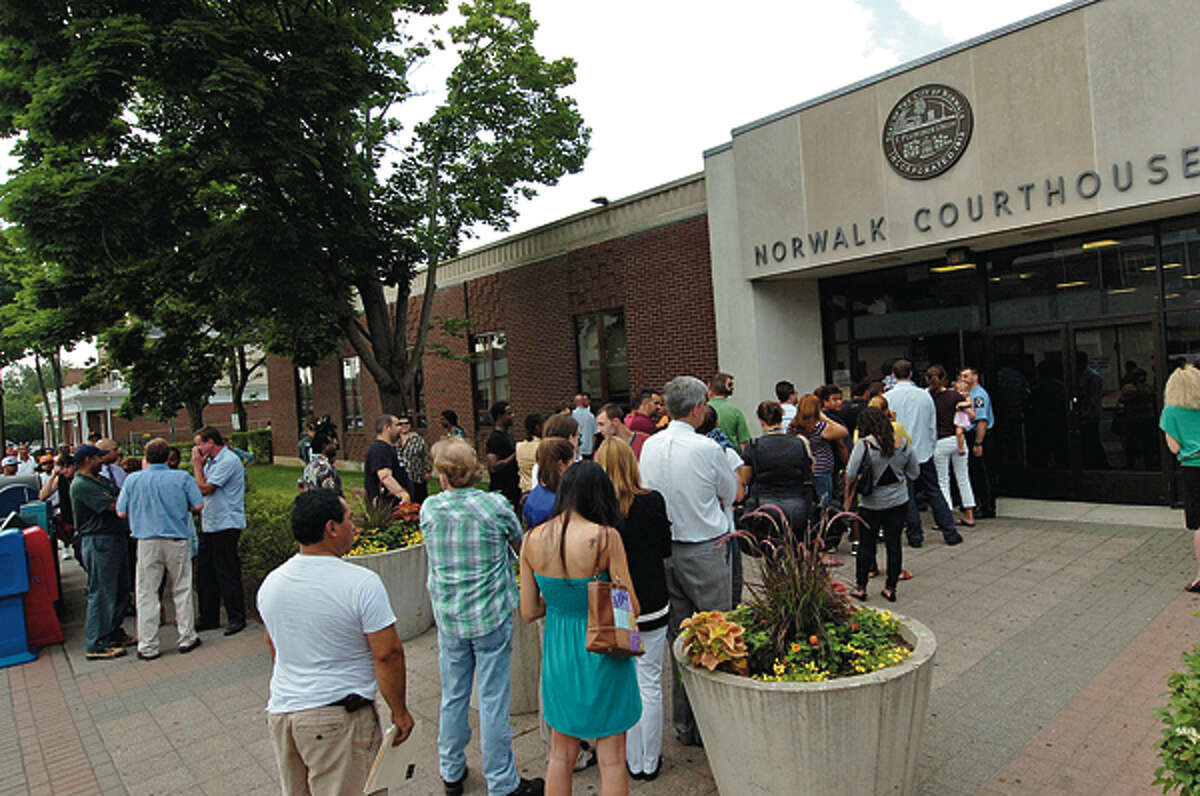 People wait outside the Norwalk Superior Courthouse Friday after a power outage forced the court to close and reschedule the docket. Hour photo / Erik Trautmann