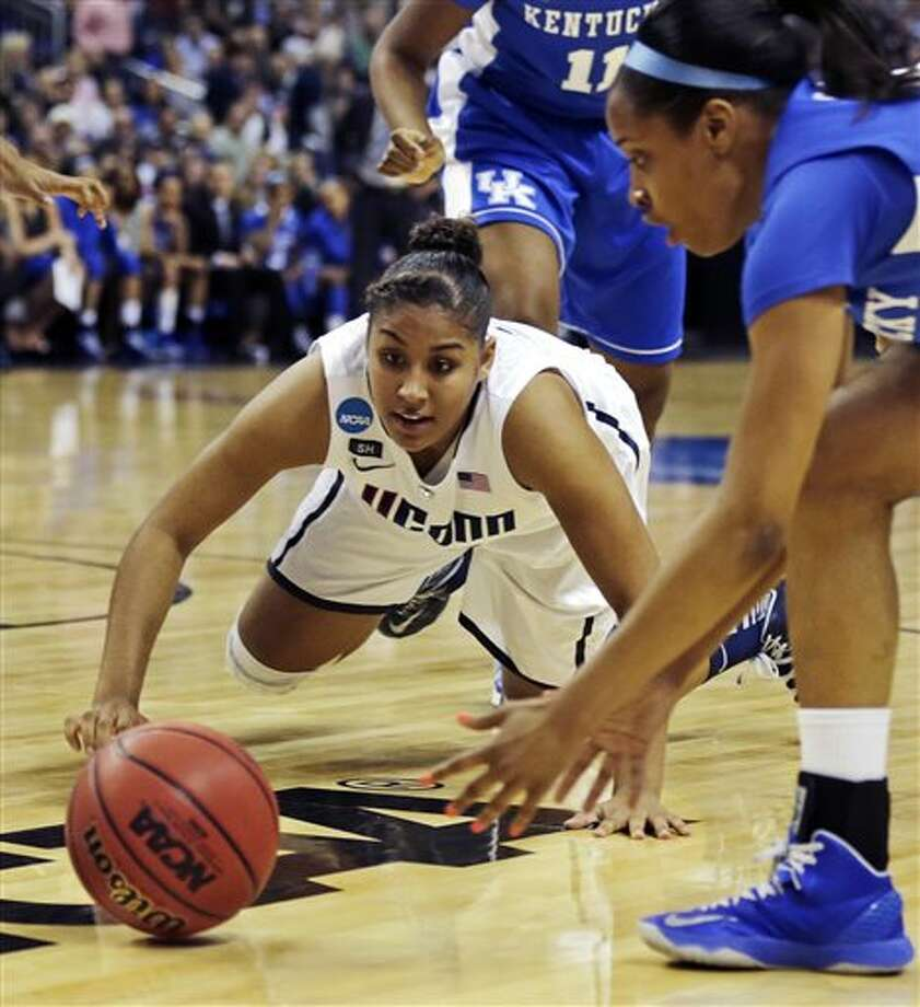 Connecticut forward Kaleena Mosqueda-Lewis, left, dives for the ball against Kentucky guard Bria Goss, right, in the first half of a women's NCAA regional final basketball game in Bridgeport, Conn., Monday, April 1, 2013. (AP Photo/Charles Krupa) / AP