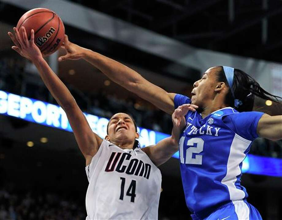 Kentucky's Jelleah Sidney, right, stops a shot attempt by Connecticut's Bria Hartley, left, during the second half of a regional final game in the NCAA college basketball tournament in Bridgeport, Conn., Monday, April 1, 2013. (AP Photo/Jessica Hill) / FR125654 AP