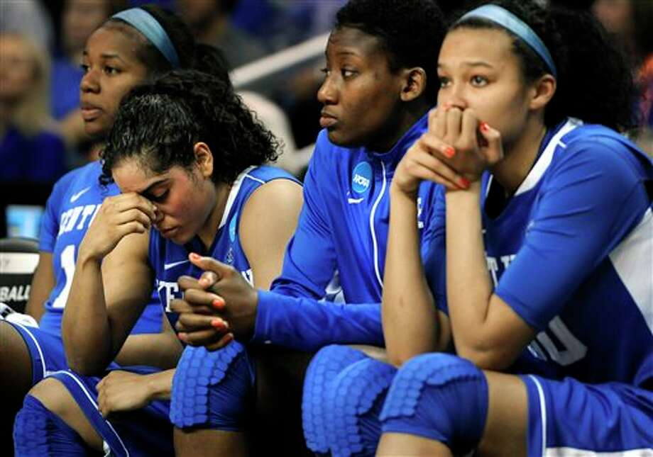 Kentucky's DeNesha Stallworth, from left, Jennifer O'Neill, Brittany Henderson and Azia Bishop react during the final minutes of their regional final game against Connecticut in the women's NCAA college basketball tournament in Bridgeport, Conn., Monday, April 1, 2013. Connecticut won 83-53. (AP Photo/Jessica Hill) / FR125654 AP