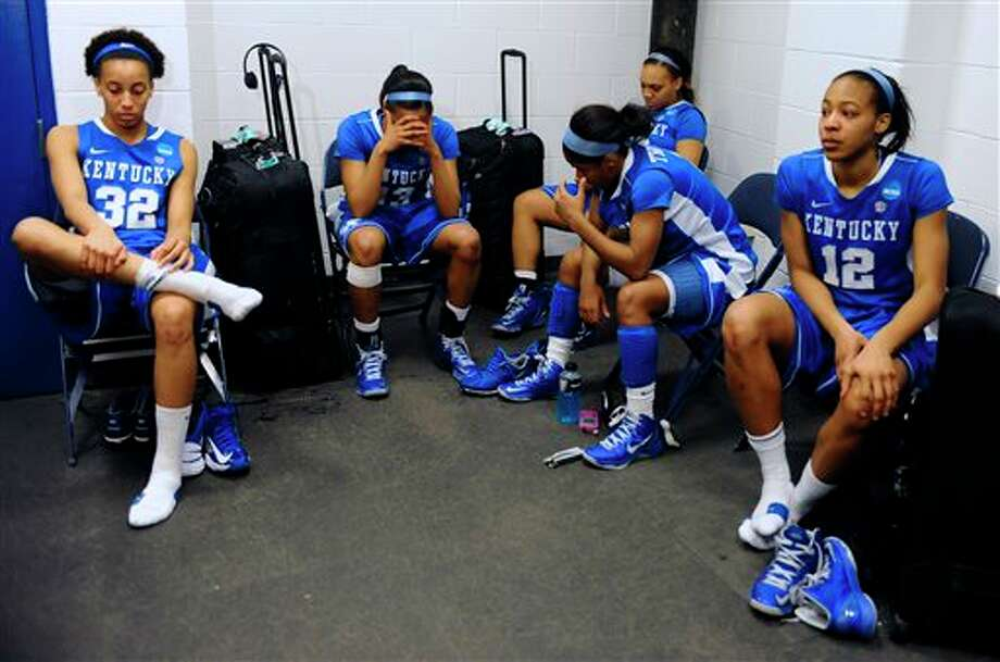 Kentucky's Kastine Evans, from left, Bria Goss, DeNesha Stallworth, Janee Thompson and Jelleah Sidney react in the locker room after losing a regional final game against Connecticut in the women's NCAA college basketball tournament in Bridgeport, Conn., Monday, April 1, 2013. Connecticut won 83-53. (AP Photo/Jessica Hill) / FR125654 AP