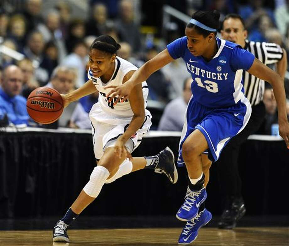 CORRECTS TO MORIAH JEFFERSON-Connecticut guard Moriah Jefferson, left, sprints down court against Kentucky guard Bria Goss (13) in the first half of a women's NCAA regional final basketball game in Bridgeport, Conn., Monday, April 1, 2013. (AP Photo/Jessica Hill) / AP