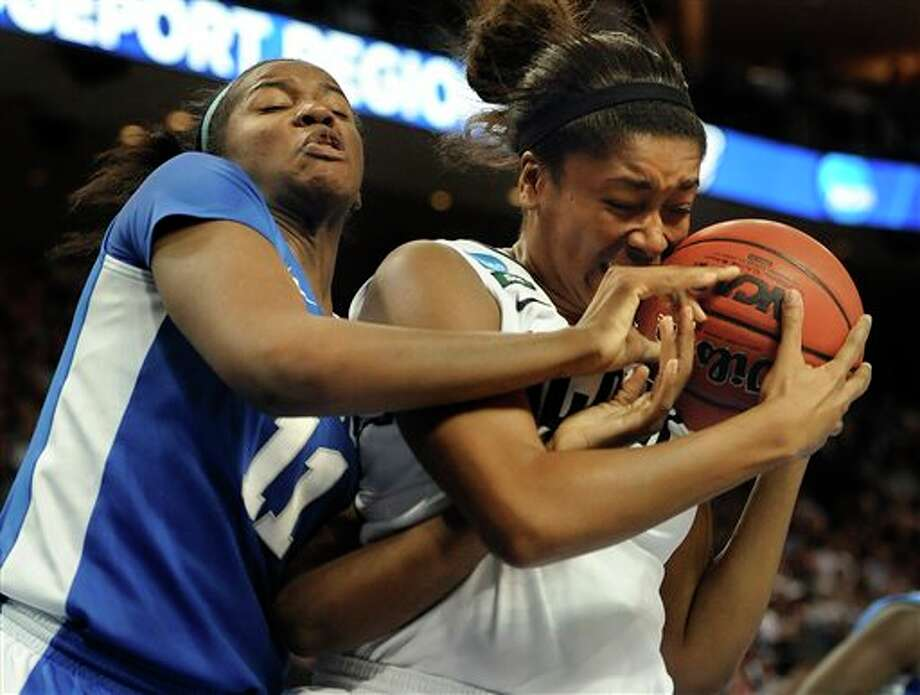 Kentucky's DeNesha Stallworth, left, tangles with Connecticut's Morgan Tuck, right, during the second half of a women's regional final game in the NCAA college basketball tournament in Bridgeport, Conn., Monday, April 1, 2013. Connecticut won 83-53.(AP Photo/Jessica Hill) / FR125654 AP