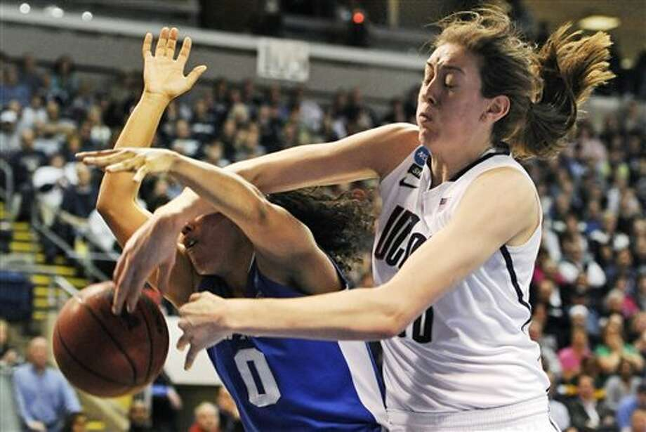 Connecticut forward Breanna Stewart, right, knocks the ball free while battling for a rebound against Kentucky guard Jennifer O'Neill (0) in the first half of a women's NCAA regional final basketball game in Bridgeport, Conn., Monday, April 1, 2013. (AP Photo/Jessica Hill) / AP