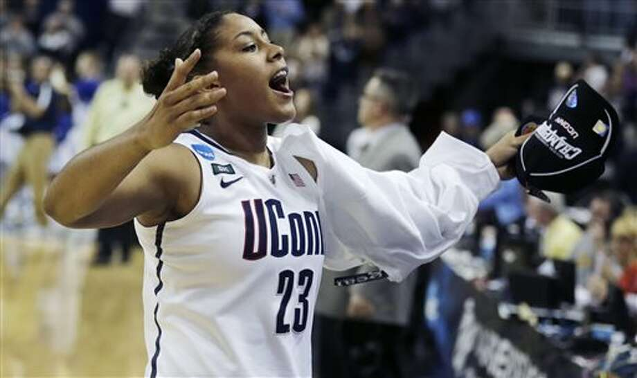 Connecticut forward Kaleena Mosqueda-Lewis celebrates after beating Kentucky in the women's NCAA regional final basketball game in Bridgeport, Conn., Monday, April 1, 2013. Mosqueda-Lewis scored 17 points in the Connecticut 83-53 win advancing them to the Final Four. (AP Photo/Charles Krupa) / AP