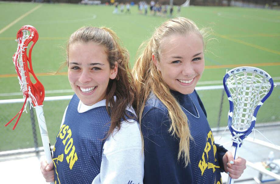 Hour photo/John NashMorgan Moubayed, left, and Taylor Swanson of Weston are both getting back on the field after missing time with knee injuries. Both players are confident they can play key roles for the Trojans girls lacrosse squad this spring.
