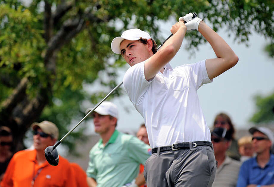 Patrick Cantlay watches his drive as a crowd looks on at the first hole hole during the second round of the Travelers Championship golf tournament in Cromwell, Conn., Friday, June 22, 2012. (AP Photo/Fred Beckham) / FR153656 AP