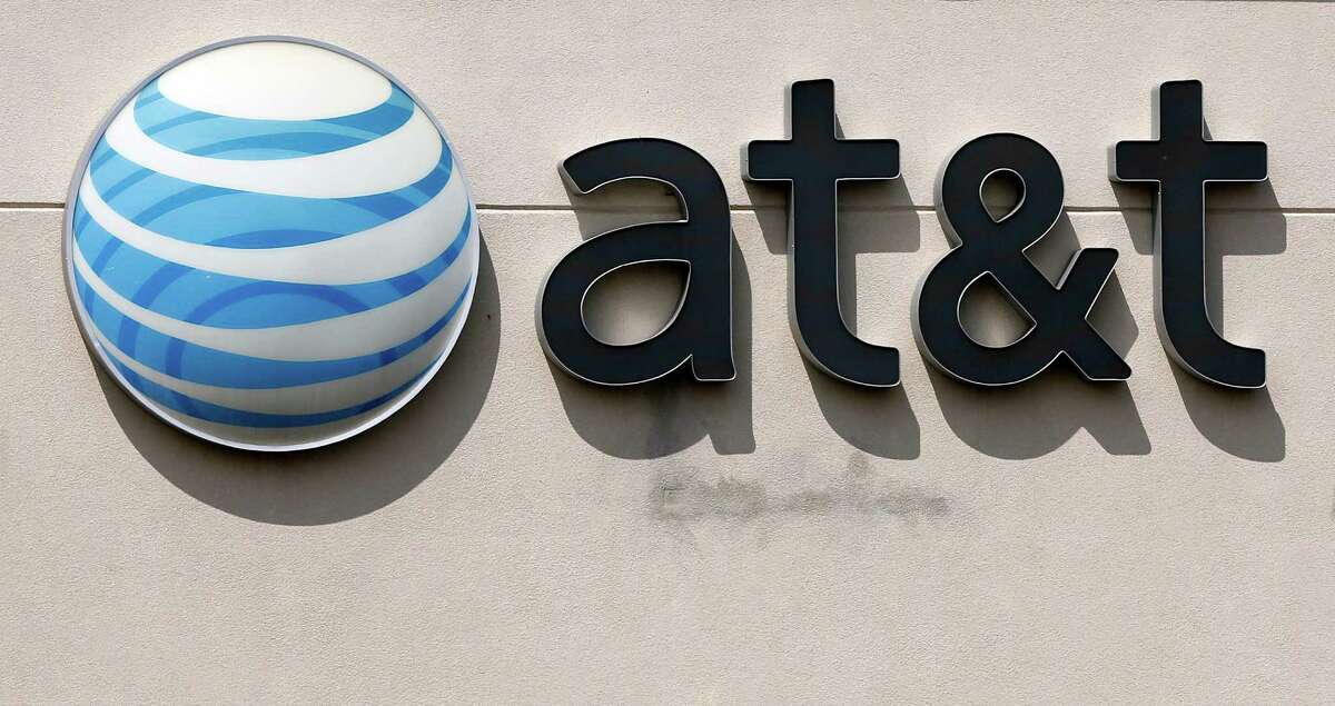"""FILE In this May 14, 2014 file photo, an AT&T logo is seen on a store in Dedham, Mass. In a big win for the Obama administration, a federal appeals court on Tuesday upheld the government's """"net neutrality"""" rules that require internet providers to treat all web traffic equally. (AP Photo/Steven Senne, File)"""