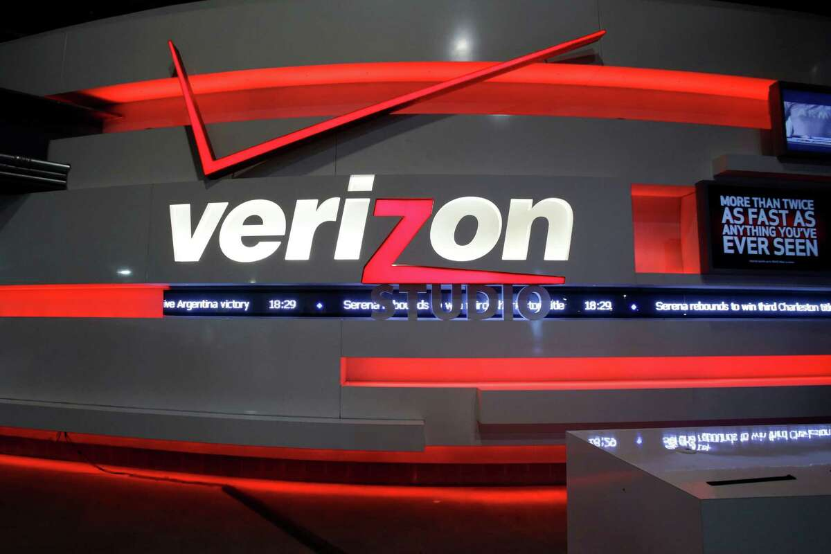 """FILE - In this April 7, 2013 file photo, the Verizon studio booth at MetLife Stadium in East Rutherford, N.J. In a big win for the Obama administration, a federal appeals court on Tuesday upheld the government's """"net neutrality"""" rules that require internet providers to treat all web traffic equally. a (AP Photo/Mel Evans, File)"""