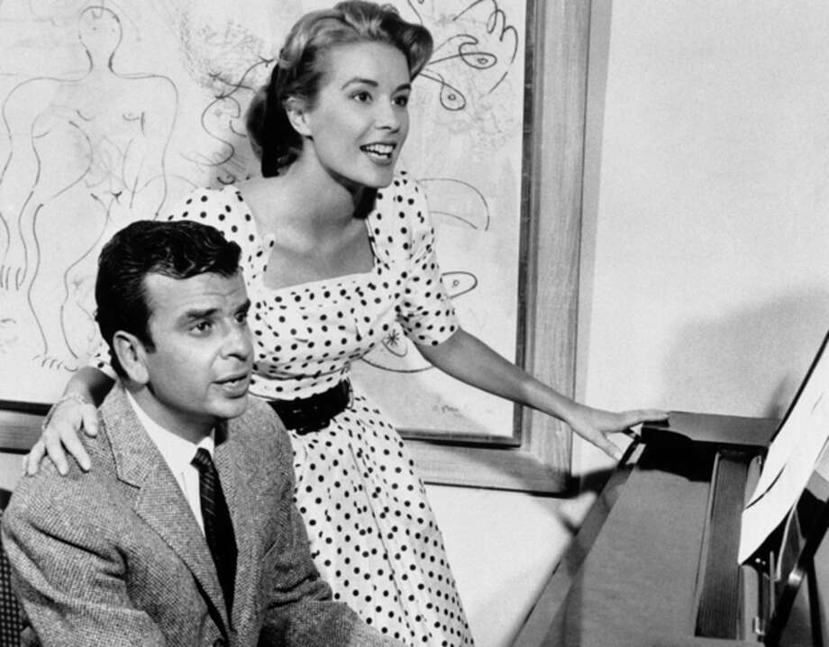 "This Sept. 8, 1961 file photo shows Broadway composer Richard Adler, left, and his wife actress-singer Sally Ann Howes in New York. Adler, who won Tony Awards for co-writing the songs for such hit musicals as ""The Pajama Game"" and ""Damn Yankees,"" died Thursday, June 21, 2012 at his home in Southampton, N.Y., according to his family. He was 90. Some of Adler's biggest songs are ""You Gotta Have Heart,"" ""Hey, There,"" ""Hernando's Hideaway,"" ""Whatever Lola Wants,"" ""Steam Heat,"" ""Rags to Riches,"" and ""Everybody Loves a Lover."" (AP Photo, file) / AP1961"