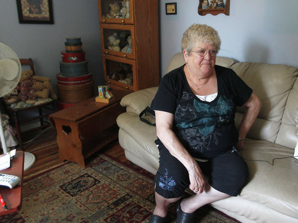 In this June 20, 2012 photo, Karen Klein, 68, of Greece, N.Y., talks about the verbal abuse she endured from Greece middle school students while she was school bus monitor. Since the incident was captured in a 10-minute video posted to YouTube, more than $120,000 has been raised to send the grandmother on vacation. The Greece School District is investigating the incident. (AP Photo/Democrat & Chronicle, Jamie Germano) MAGS OUT; NO SALES