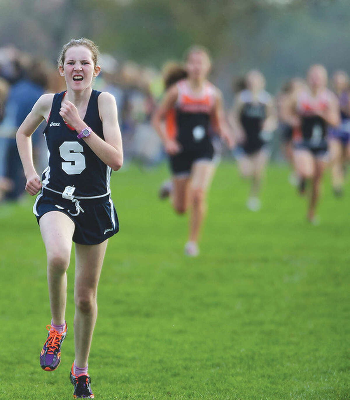 Photo by Fred Gaston Staples High junior Caroline Koenig, seen here running in the 2011 FCIAC Championship meet, was hit by a car while on a training run on Tuesday in Westport.