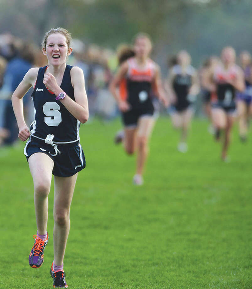 Photo by Fred GastonStaples High junior Caroline Koenig, seen here running in the 2011 FCIAC Championship meet, was hit by a car while on a training run on Tuesday in Westport.