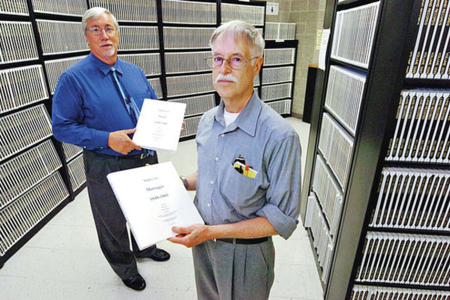 Hour photo / Erik TrautmannAmateur genealogist Paul Keroack and Norwalk Town Clerk Rick McQuaid have worked with the staff of the Town Clerk's Office to develop an index for vital records. / (C)2012, The Hour Newspapers, all rights reserved