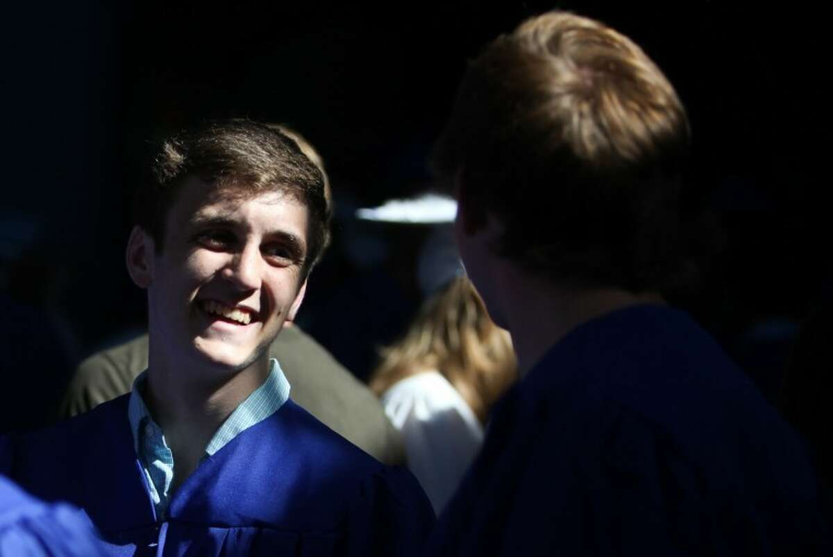 Brendan Huber jokes with his friends before Wilton High School's graduation Saturday. Hour Photo / Chris Palermo