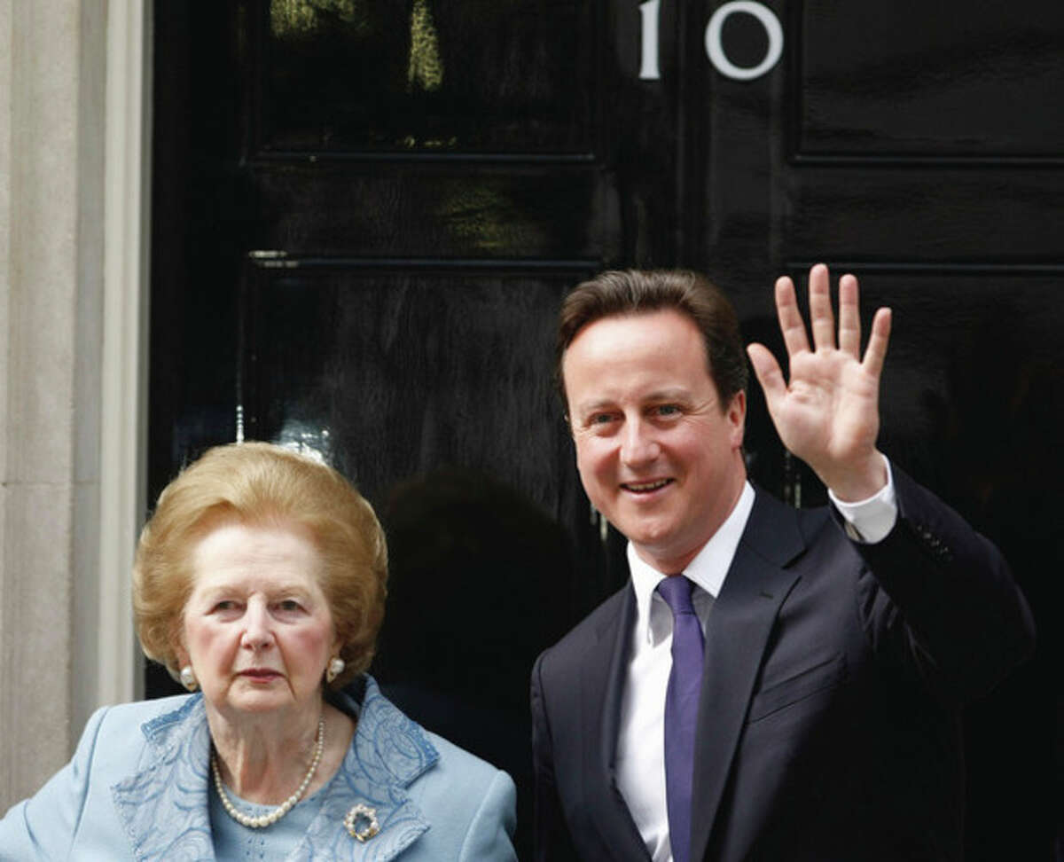 """FILE - This is a Tuesday, June, 8, 2010 file photo of Britian's Prime Minister David Cameron poses with former Prime Minister Margaret Thatcher on the doorstep of 10 Downing Street in London. Ex-spokesman Tim Bell says that Thatcher has died. She was 87. Bell said the woman known to friends and foes as """"the Iron Lady"""" passed away Monday morning, April 8, 2013. (AP Photo/Alastair Grant,File)"""