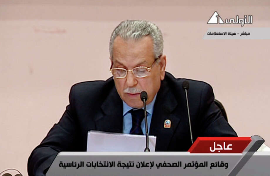In this image taken from Egypt State TV, Judge Farouk Sultan, chairman of Egypt's election committee, announces the result of the presidential election at the State Information Service headquarters in Cairo, Egypt, Sunday, June 24, 2012. Egypt's electoral commission announced Sunday that Mohammed Morsi is victor of landmark presidential vote. (AP Photo/Egypt State TV) MANDATORY CREDIT / EGYPT TV