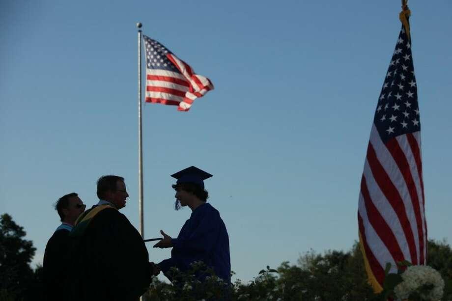 A Wilton High School senior recieves his diploma Saturday evening at Wilton High Schools commencement ceremonies. Hour Photo / Chris Palermo
