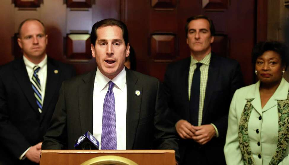 Senator Todd Kaminsky is joined by other members of the Senate Democratic Conference in urging the Senate Majority to pass legislation that will decouple performance reviews from state aid prior to the end of the legislative session during a press conference Tuesday June 14, 2016 at the State Capitol in Albany, N.Y. (Skip Dickstein/Times Union)