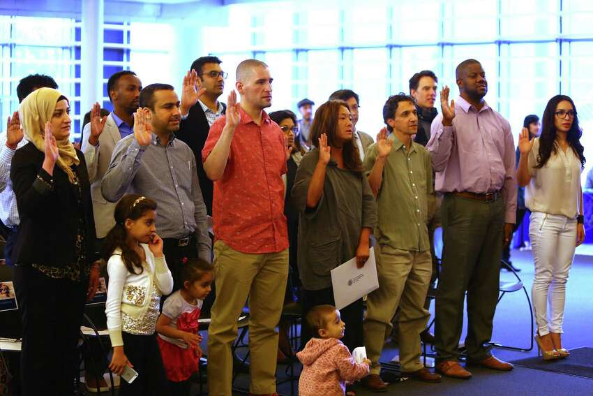 Seattle's 19 newest citizens recite the oath of allegiance.