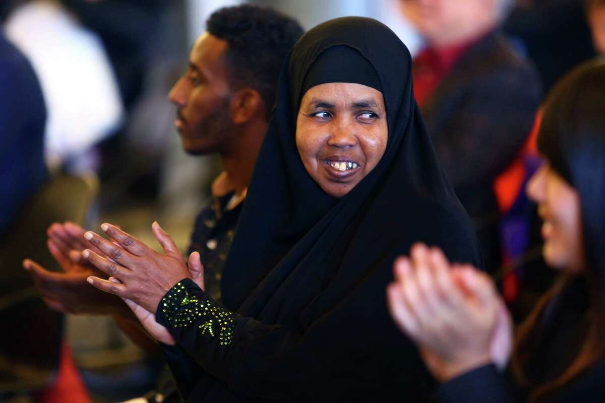 Fardowsa Omar Haji, from Somalia, smiles as she and 18 other new U.S. citizens are sworn in.