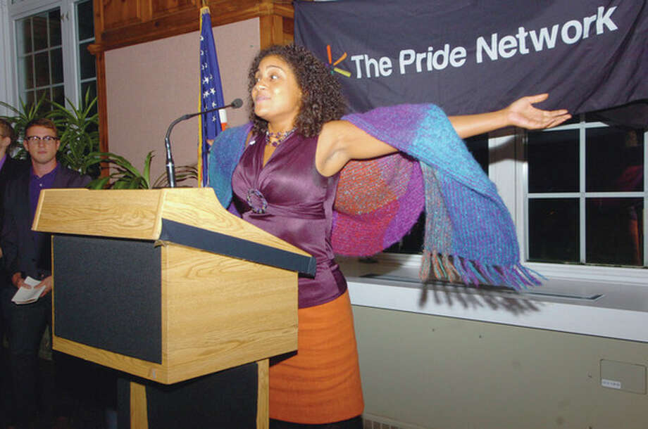 Hour photo / Jordan Osterhout Mentoring coordinator Kamora Herrington, from True Colors, Inc., speaks during a vigil held to protest bullying and discrimination against gay youths at Norwalk's City Hall Wednesday night. / (C)2011, The Hour Newspapers, all rights reserved