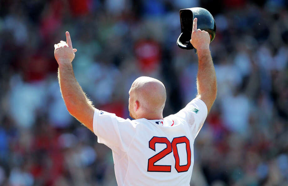 Boston Red Sox's Kevin Youkilis (20) raises his arms to the crowd as he comes off the field after hitting a triple and being replaced with a pinch-runner in the seventh inning of a baseball game against the Atlanta Braves in Boston, Sunday, June 24, 2012. (AP Photo/Michael Dwyer) / AP